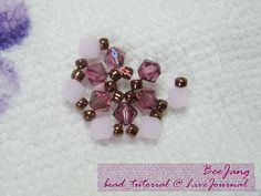 Tutorial : Flower Motif #1 Level : Beginner to Intermediate Warning : Heavy pictures under cut. I don't have a pattern for this one. I just adapt from the other pattern. What you need : - 4 mm. Bicones Swarovski Crystal. - Seed beads. - Nylon coated thread no. 20. 1. We start from the middle. Cut…
