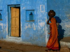 Woman Carrying Waterpot on Her Head, Orchha, Madhya Pradesh, India by Anders Blomquist. Photographic print from Art.com.