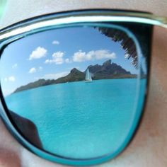Reflection of Bora Bora in the #Balmain I frame by @Alice Cartee Hayes