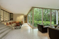 Mid-Century Modern - with a built-in sitting area and expansive backyard views.