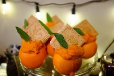 Sweet potato-stuffed oranges topped with rosemary orange shortbreads -  Becca Dilley / Heavy Table