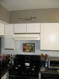 """Handmade """"Mise en Place"""" tray over the stove, and Julia Child quotes to inspire smiles."""