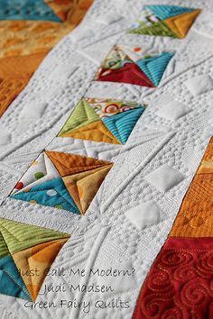 I like the quilting of the square!