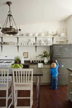 Bold move to paint your fridge with chalkboard paint!