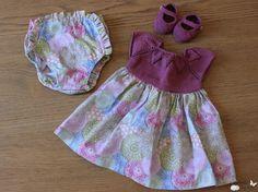 mariposa tricotosa: Vestido con cuerpo de punto y escote en hojas para bebé