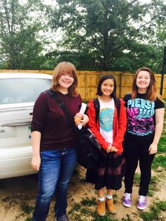 Jitkamon's first day of school pictured with her host sisters in Grayling, MI.