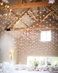 A Thousand origami cranes at the wedding of Adele & Bill at Hyde Barn- The symbol of eternal good luck...