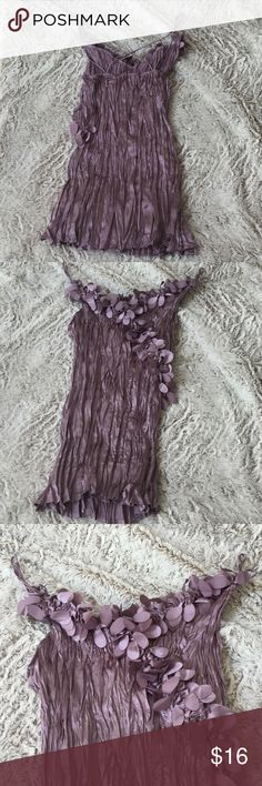 Silky Lavender scrunchy top. Showcase the beautiful sheen on this deep lavender/lilac colored top.  Scrunchy texture with straps that criss cross in the back.  Form fitting yet silky to the touch and easy to care for.100% polyester, hand wash gently and lay flat to dry. Lapis Tops Blouses
