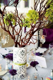 Wedding centerpiece using branches & hanging votive candles.