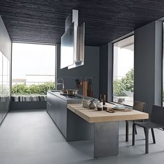 Deep grey and glass kitchen with oversize windows