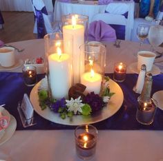 Our simple candle centerpiece : wedding Centerpieces- something like this but without the mirror or plate thing. Maybe on an old wine box crate? Cheap Wedding Centerpieces For Sale Unique Centerpieces, Wedding Table Centerpieces, Flower Centerpieces, Wedding Decorations, Table Decorations, Centerpiece Ideas, Flower Arrangements, Mirror Centerpiece, Table Violet