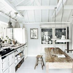 Using furniture pieces in kitchen instead of all built-ins..
