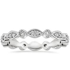 I totally love this ring, its intricate yet simple!  18K White Gold Tiara Eternity Diamond Ring from Brilliant Earth