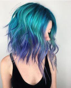 Vibrant hair color by @tamiramae and @zackofallfades #pulpriothair