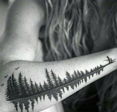 """Cool idea for a sound wave tattoo: turn it into a lake w/ trees. This one's a father saying """"Babydoll"""""""