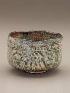 Tea bowl in style of Korean punch'ong ware, unknown Raku ware workshop mid 18th - mid 19th century Edo period Raku-type earthenware with white slip inlaid under clear, colorless glaze H: 8.3 W: 12.5 cm Kyoto, Japan