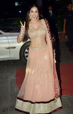 Sunny Leone In A Peachy Pink #Lehenga At Tulsi Kumar's Wedding Reception In Mumbai.