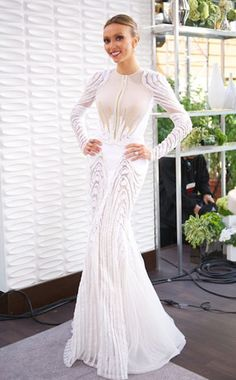 We LOVE Giuliana's long-sleeved Basil Soda gown that she wore for the Countdown to the Red Carpet show at the Oscars! Can you say GORGEOUS? #StyleNetwork #GandB