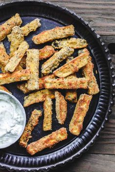 Baked Eggplant Fries with Greek Tzatziki Sauce The Mediterranean Dish. Quick, simple and addictive! These eggplant fries are crispy on the outside, super tender and velvety on the inside. Served with Greek tzatziki sauce. See the easy recipe on TheMedit Sauce Tzatziki, Homemade Tzatziki Sauce, Baked Eggplant Fries, Crispy Eggplant, Vegetarian Appetizers, Ovo Vegetarian, Vegetarian Recipes, Mediterranean Dishes, Mets