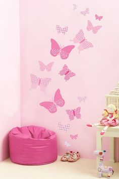 """Decorate a little girl's bedroom, nursery or playroom with these butterflies wall decals filled with vintage patterns in shades of pink. Butterfly decals measure 2.5"""" - 10"""" wide. Design a beautiful fe"""