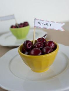Life is just a bowl of cherries, especially during the summer. Download and print this place card template, handwrite guests' names on each flag and use double-sided tape to wrap around wooden skewers. Stick upright into a bowl of fresh cherries, and place at each table setting. Guests will love locating their seat to discover a fresh bowl of fruit, all theirs for the snacking.