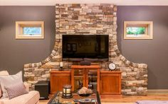 Basement remodel with stonewall fireplace in Indianapolis remodeled by CASEIndy