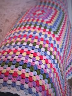 Granny square blanket on the arm of of sofa