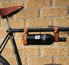 If you like wine and you like biking, you're going to love this. The handmade leather bicycle wine rack is perfect for taking wine with you on the go. Easily attaches to any 1″ bike frame with antique brass fasteners, while the hidden clamps hold the bottle securely. The olive oil-treated vegetable-tanned leather will only look better as it ages. Adjustable to fit different types of 3″ bottles Please allow 1-2 weeks for delivery.