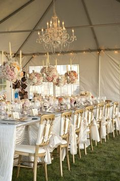 white, blush and gold wedding reception with chandeliers and candelabra centerpieces. so divine!
