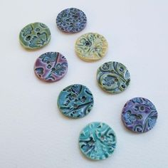 Multi-coloured ceramic buttons. Make w polymer clay and use as embelishments or charms.