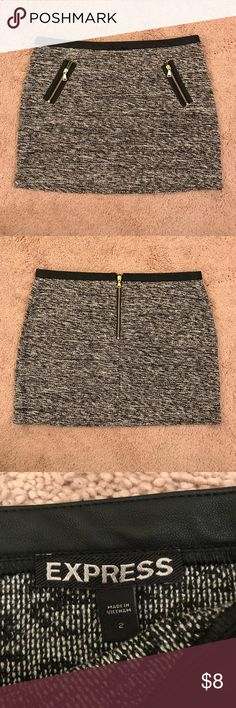 Mini skirt from express. Size 2. Has two functional pockets in the front. Express Skirts Mini