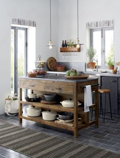 Like a treasured vintage find or a custom-designed piece, this elegant kitchen island serves as a rustic yet refined workstation for the home cook or entertaining enthusiast. Bluestone is crafted with reclaimed pine from old buildings and doors and a lust Rustic Kitchen Island, Rustic Kitchen Design, Home Decor Kitchen, Country Kitchen, Kitchen Furniture, New Kitchen, Vintage Kitchen, Kitchen Ideas, Kitchen Islands