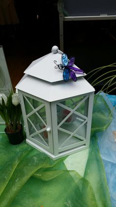 Lattice Mirrored Lantern. Can be used as a wall sconce or a gazebo style centerpiece. $190 for 2 piece set. Dragonfly clip sold separately. http://www.partylite.biz/legacy/sites/rdiazcandles/productcatalog?page=zmagCatalog&zmagType=mobileRedirect2012&zmagCatalogId=002031e7&zmagCatalogName=Summer%202015
