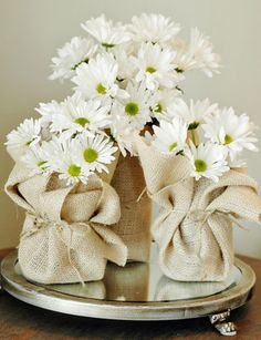 wrap burlap (or any fabric) around jars and tie with ribbon or string. Would be really cute with mums for fall!