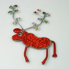 Check out these stunning African Beaded Christmas Ornaments at www.christmaswithaheart.com Beaded Christmas Ornaments, Christmas Decorations, African Crafts, African Beads, All Things Christmas, Crochet Earrings, Drop Earrings, Heart, Check