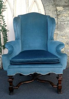 A MID GEORGIAN WING BACK ARMCHAIR OF SUPERB QUALITY, WITH INTERESTING CARVED HOOF FOOT LEGS. RECENTLY REUPHOLSTERED AND RECOVERED. SOLD