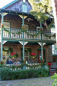 Double Porches in St. Augustine, Florida!!! Bebe'!!! Decorated with southern pine roping and red bows!!!