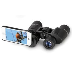 The iPhone Binoculars - Hammacher Schlemmer- 8X magnification for a 465 foot view at 1,000 yards.  Works with iPhone camera for picture taking.  $99.95