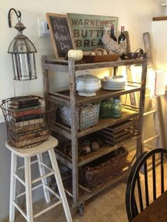 Cool rack shelf-like this vignette with old books stacked inside of wire basket on top of stool