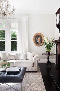 Coco Republic Interior Design transformed this Surrey Hills home in Melbourne into a charming and welcoming family retreat. Get the look with the French Empire Sofa and Jonathan Ottoman. #CocoRepublic #OlyStudio #interiordesign #styling #livingroom