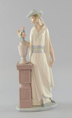 Lladro figure of 1920's woman by a vase of flowers, : Lot 913