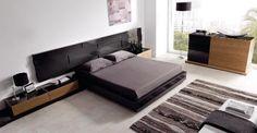 Dormitorio en negro y madera