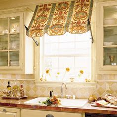 Love the kitchen awning look!  Kitchen Makeover on a Budget | Details Make the Difference | SouthernLiving.com