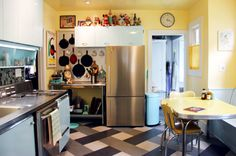 The marmoleum click floor is one of Letitia's favorite parts of the kitchen and is a nice neutral with all the blue and yellow.