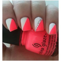 Neon pink and white nails with silver rhinestones on ring finger.