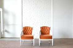 Zuni - This dazzling duo of upholstered chairs features a cheerful orange fabric with bright white trim. The button tufted backs add a romantic flair to these beauties which are perfect for sweetheart seating or lounge areas! Paisley & Jade...Vintage & Eclectic Furniture Rentals for Events, Weddings & Photo Shoots*