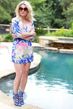 Erin from Busbee Style is abloom in a floral romper and caged heels