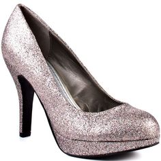 Nelly - Silver  Fancy up your look in this New Years Eve approved pump from Fergie. Nelly has a 1/2 inch platform and 4 inch heel covered in a multi color glitter to make you sparkle under the disco ball.  $44.99