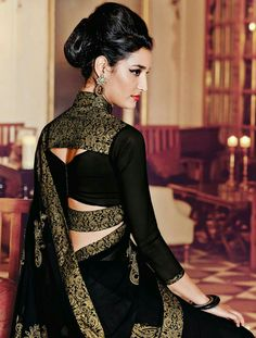 25 Latest Black Saree Blouse Designs Black is a color that looks very interesting, classy and one can never go wrong in a black outfit. In fact, black also makes you look slim and hide the flabs. We've compiled the list of the beautif… Indian Blouse Designs, Saree Blouse Neck Designs, Stylish Blouse Design, Fancy Blouse Designs, Saree Blouse Patterns, Designer Blouse Patterns, Bridal Blouse Designs, Latest Blouse Designs, Latest Blouse Patterns