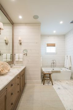 the master bathroom tile simulates the hardwood floor in the main